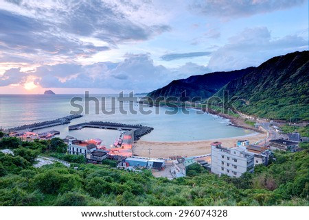 Aerial view of a fishing village at dawn on northern coast of Taipei Taiwan ~ Beautiful coastal scenery with moody sunrise sky - stock photo