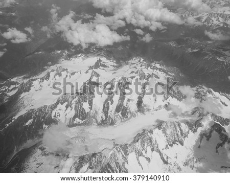 Aerial view of a glacier in Alps mountains in black and white
