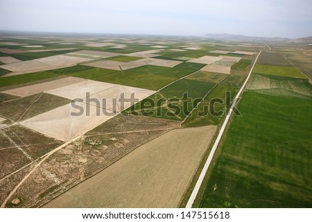 Aerial view of a green rural area under blue sky. Konya - stock photo