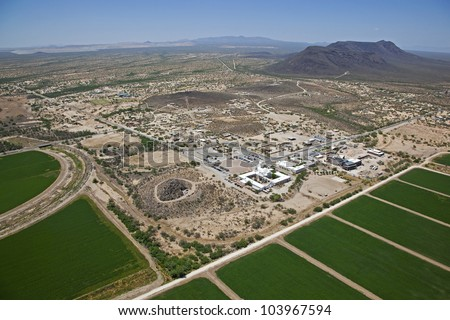 Aerial view of a historic Spanish mission and surrounding area in the Sonoran desert near Tucson, Arizona - stock photo
