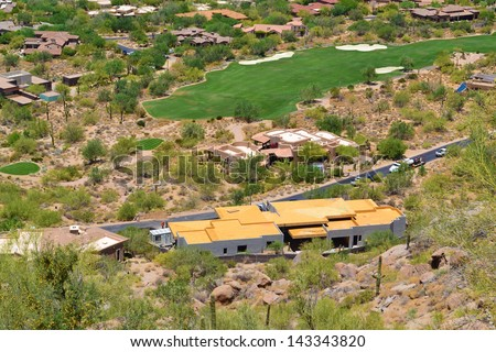 Aerial View of a House on a Golf Course in Scottsdale, Arizona from the Top of Pinnacle Peak Mountain  - stock photo