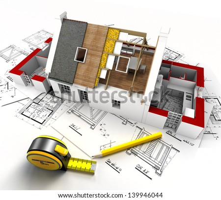 Aerial view of a house under construction, with blueprints and architect work tools - stock photo
