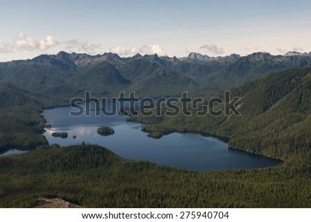 Aerial view of a lake, Skeena-Queen Charlotte Regional District, Haida Gwaii, Graham Island, British Columbia, Canada - stock photo