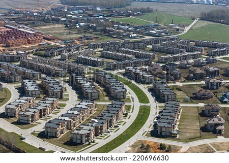 Aerial view of a modern suburban  townhouses near Novorigskaya highway in Russia - stock photo