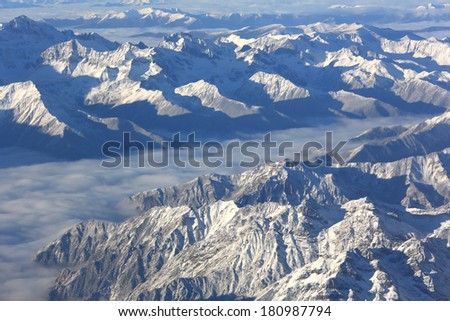 Aerial View of a Mountain Range above China  - stock photo