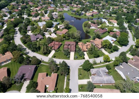 Aerial view of a neighborhood in suburban Chicago with a center pond.