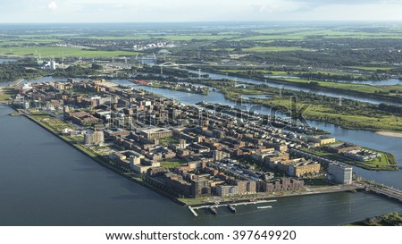 Aerial view of a new district in Amsterdam IJburg, Netherlands with a lot of colorful houses. - stock photo