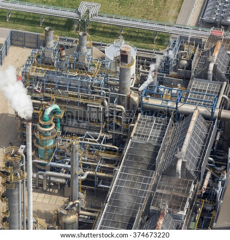 Aerial view of a part of a fertilizer factory with chimneys and steam. - stock photo