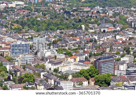 Aerial view of a residential part of the city of Frankfurt am Main, Germany, from the observatory deck of the Main tower. Frankfurt is the largest financial center in continental Europe. - stock photo