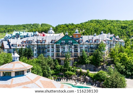Aerial View of a Resort Complex, and in the background one of the mountains of Mont Tremblant Quebec. - stock photo