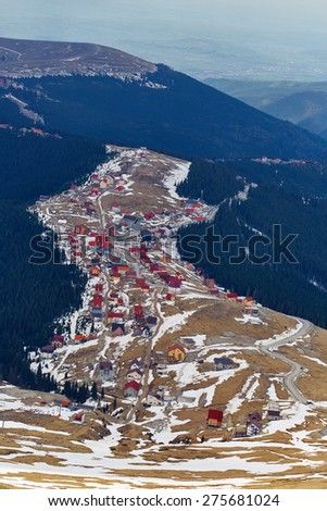 Aerial view of a resort in construction on a mountain - stock photo