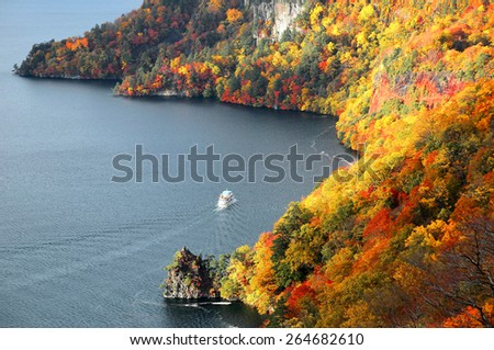 Aerial view of a sightseeing boat on autumn Lake Towada, Aomori Japan - stock photo