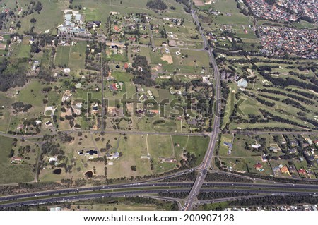 Aerial view of a typical highway exits and overpass near an industrial and commercial area in Australia - stock photo