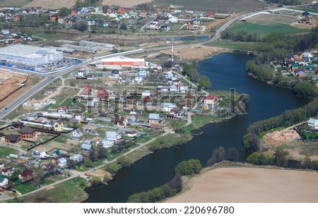 Aerial view of a village and river in Russia - stock photo