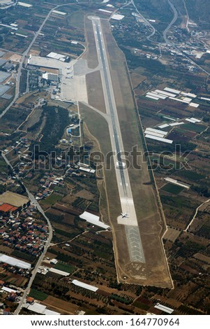 Aerial view of airport and airplane before take off  - stock photo