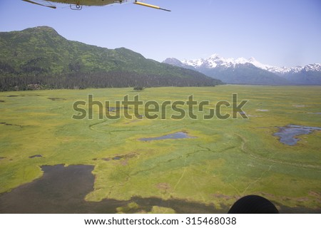 Aerial view of alaskan wilderness from a light airplane - stock photo