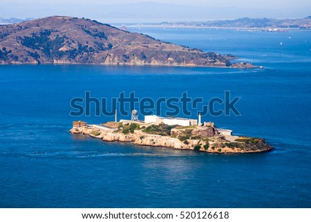 Aerial view of Alcatraz island with Angel Island in the background.