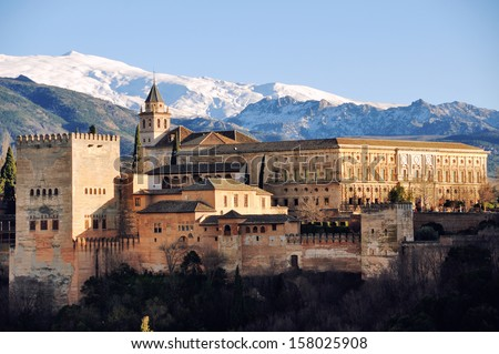 Aerial view of Alhambra Palace in Granada, Andalusia, Spain - a moorish fortress included in the UNESCO World Heritage Site. Sierra Nevada snowy mountains at the background - stock photo