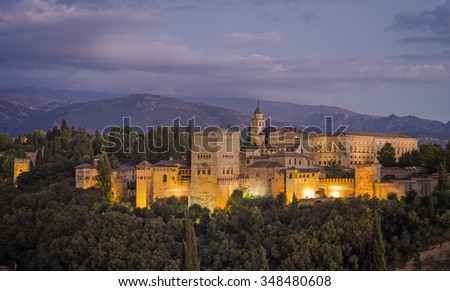 Aerial view of Alhambra Palace in Granada, Spain with Sierra Nevada mountains at the background  - stock photo