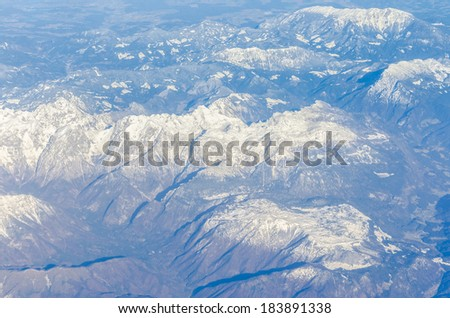 aerial view of Alps mountain range - stock photo
