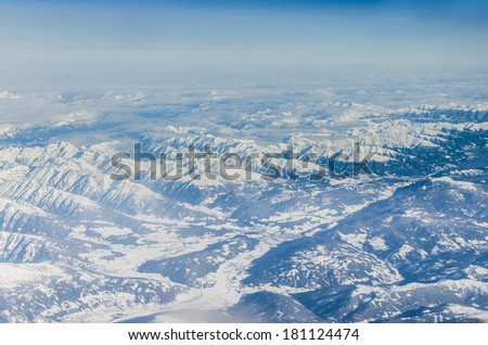 Aerial view of Alps mountains - stock photo