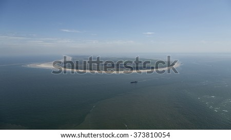 Aerial view of Ameland, an island in the Waddenzee, Holland. The Waddenzee is on the UNESCO world heritage list. - stock photo