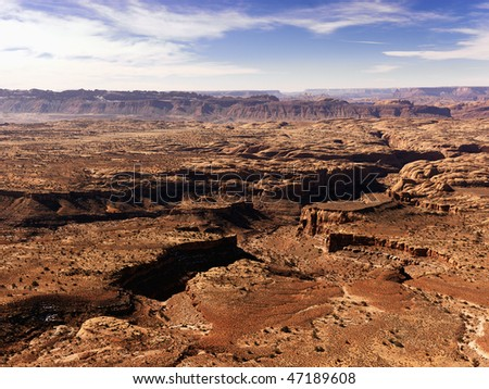 Aerial view of an arid, craggy landscape. Horizontal shot.