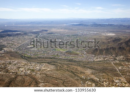 Aerial view of an upscale community near Phoenix, Arizona with Lake Pleasant in the distance - stock photo