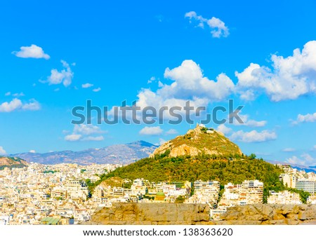 Aerial view of Athens town with lecabetus hill from Acropolis rock in Greece - stock photo
