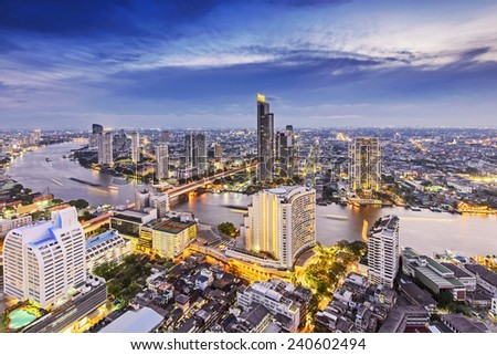 Aerial view of Bangkok city with Chao Phraya river during sunset  - stock photo