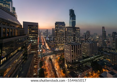 Aerial view of Bangkok modern office buildings, condominium in Bangkok city downtown with sunset and twilight sky , Night city Bangkok Thailand