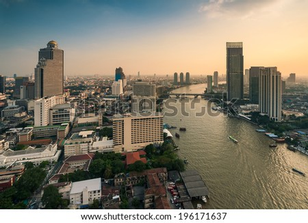 Aerial view of Bangkok Skyline along Chaophraya River at Sunset