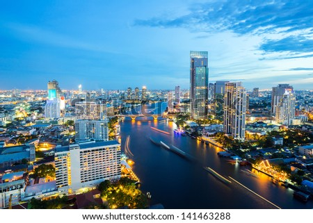 Aerial view of Bangkok Skyline along Chaophraya River sunset twilight - stock photo