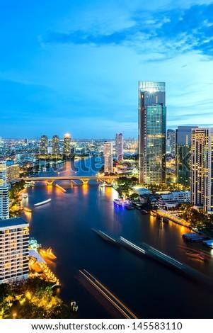 Aerial view of Bangkok Skyline along Chaophraya River sunset twilight - stock photo
