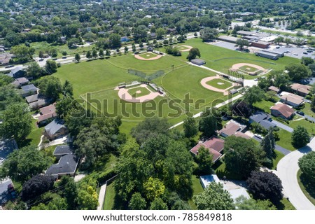 Aerial view of basebal fields at a suburban middle school near a residential neighborhood in Glenview, IL. USA
