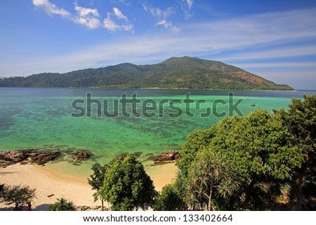 Aerial view of beach and turquoise crystal Andaman sea against blue sky at Koh Lipe in Satun, Thailand - stock photo