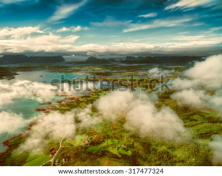Aerial view of beautiful Lofoten islands in Norway from above the clouds - stock photo