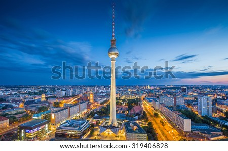 Aerial view of Berlin skyline and dramatic clouds in twilight during blue hour at dusk, Germany - stock photo