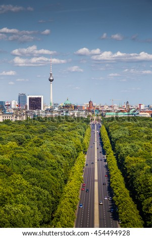 Aerial view of Berlin skyline panorama with Grosser Tiergarten public park on a sunny day with blue sky and clouds in summer seen from famous Berlin Victory Column (Berliner Siegessaeule), Germany - stock photo
