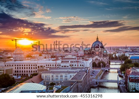 Aerial view of Berlin skyline with famous Berlin Cathedral and Spree river in beautiful golden evening light with clouds at sunset with retro vintage Instagram style toned filter effect, Germany - stock photo