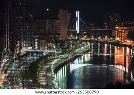 Aerial view of Bilbao, Spain city downtown with a Nevion River and promenade at Night - stock photo