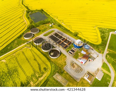 Aerial view of biogas plant from pig farm in rapeseed fields. Renewable energy from biomass. Modern agriculture in Czech Republic and European Union.
