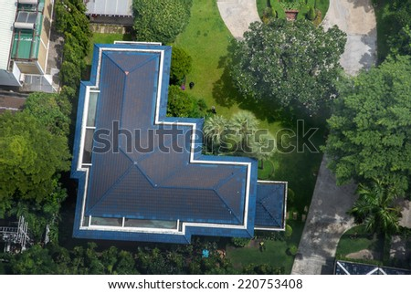 Aerial view of blue roof house - stock photo