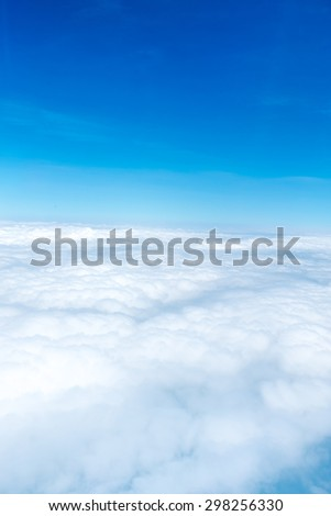 Aerial view of Blue sky and Cloud Top view from airplane window,Nature background.