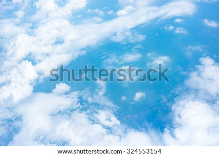 Aerial view of Blue sky and Cloud Top view from airplane window,Nature background. - stock photo