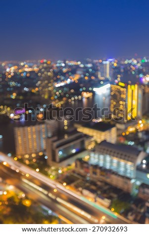 Aerial view of bokeh light skyline Bangkok city with main river curve