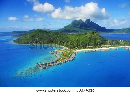 Aerial View of Bora Bora with overwater Bungalows. - stock photo