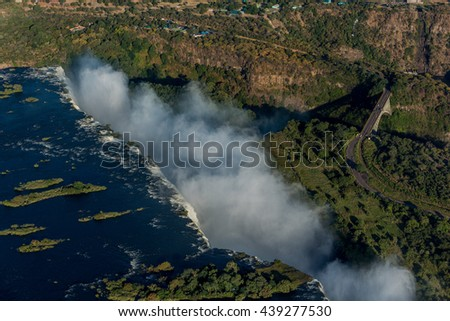 Aerial view of bridge beside Victoria Falls