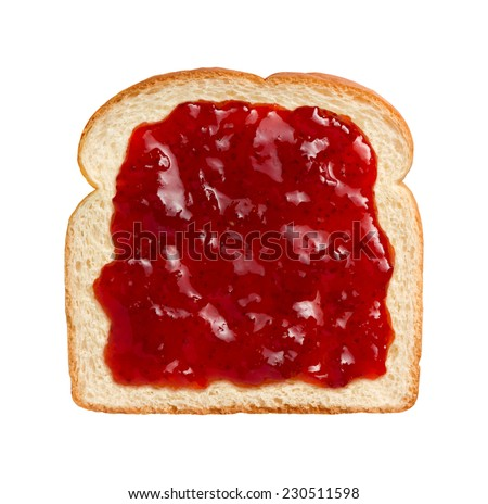Aerial view of bright red strawberry preserves, spread over a slice of white bread. This can be eaten as shown or combined with another piece of bread and other ingredients to make a sandwich.  - stock photo