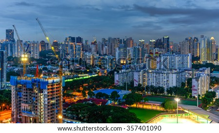 Aerial view of building construction site near the residential apartments skylines at Redhill neighborhood in Singapore at blue hour. Urban high rise construction and development concept. Panoramic - stock photo